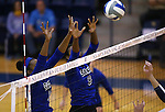 Marymount's Margaret McAlpin and Morgan McAlpin block against St. Mary's during a college volleyball game in Lexington Park, MD, on Wednesday, Oct. 29, 2014. Marymount won 3-2 to go 24-9 on the season.<br /> Photo by Cathleen Allison