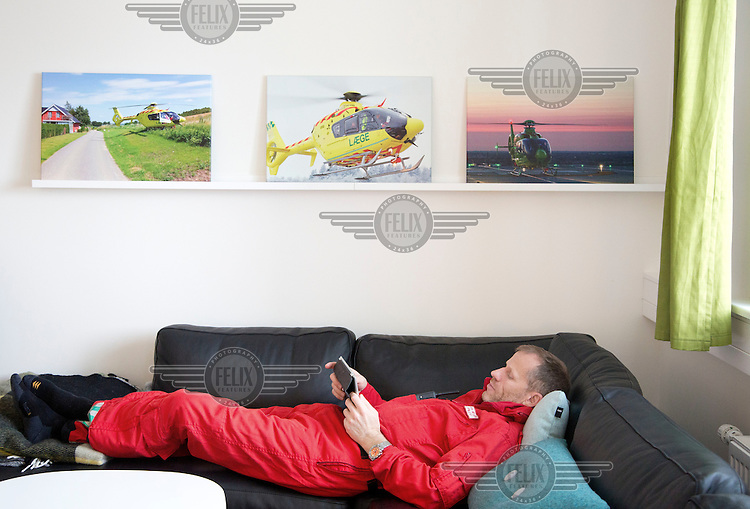 Pilot Jan Nielsen relaxing between missions. Denmarks first  air ambulance serivce, operated by Norwegian Air Ambulance. The crew is pilot Jan Nielsen, HEMS paramedic Lars Greve-Wilms and doctor Rikke Helene Rasmussen. <br />