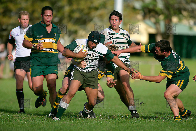 T. Ropotini is stopped by J. Maher & B. Farrell. Counties Manukau Premier Club Rugby, Pukekohe v Manurewa  played at the Colin Lawrie field, on the 17th of April 2006. Manurewa won 20 - 18.