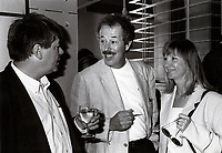 Montreal, CANADA, August 1995 File Photo (exact date unknown),Film Makers<br /> Andre Forcier (L), Denys Arcand (M) and his wife (R) at the 1994 World Film Festival.<br /> <br /> Photo : Agence Quebec Presse - Pierre Roussel