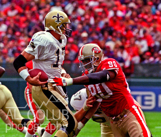 San Francisco 49ers vs. New Orleans Saints at Candlestick Park Sunday, October 29, 1995.  Saints beat 49ers  11-7.  San Francisco 49ers defensive tackle Junior Bryant (90) sacks New Orleans Saints quarterback Jim Everett (17).