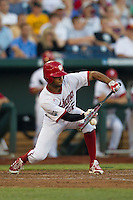 Indiana Hoosiers outfielder Justin Cureton (22) lays down a bunt against the Mississippi State Bulldogs during Game 6 of the 2013 Men's College World Series on June 17, 2013 at TD Ameritrade Park in Omaha, Nebraska. The Bulldogs defeated Hoosiers 5-4. (Andrew Woolley/Four Seam Images)