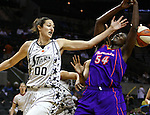 San Antonio's Ruth Riley (00) makes contact with Mercury player Barbara Farris (54) during the WNBA game between the San Antonio Silver Stars and the Phoenix Mercury, May 20, 2008, at the AT&T Center, San Antonio, Texas. San Antonio won 81 - 76. (Darren Abate/PressPhotoIntl.com)