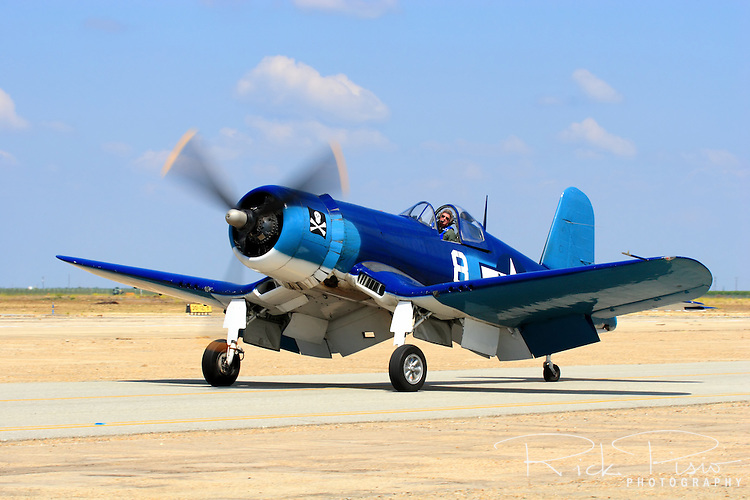 Chuck Wentworth taxies an FG-1D Corsair after arriving at Minter Field prior to the start of the 2007 Warbirds in Action airshow. The Corsair was pirmarily known as a Marines fighter plane during the Second World War with an ability to out climb and out dive the primary Japanese fighter, the A6M Zero. The aircraft's performance advantage, its ability to take severe punishment, and six .50-caliber Browning machine guns gave Navy and Marine pilots the advantage in the skies over the Pacific. Corsairs also flew in combat during the Korean War as well as the 1969 Football War between Honduras and El Salvador