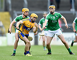 Jason Mc Carthy of Clare in action against Darren O Connell and Brian Ryan of Limerick during their Munster U-21 hurling quarter final at Cusack park. Photograph by John Kelly.