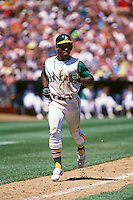 OAKLAND, CA - Rickey Henderson of the Oakland Athletics in action during a turn back the clock day game against the California Angels at the Oakland Coliseum in Oakland, California in 1992. Photo by Brad Mangin