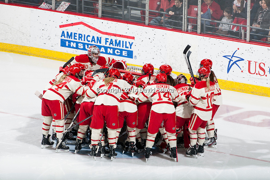 Wisconsin Badgers teammates huddle prior to an NCAA college women's hockey game against the Minnesota Golden Gophers Saturday, February 15, 2014 in Madison, Wis. The Golden Gophers won 4-0. (Photo by David Stluka)