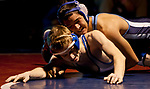 Carson's Kyle Sharp, top, wrestles McQueen's Mike Paulk in the 120 pound weight class during the Division 1 NIAA Region Wrestling  Championship on Saturday afternoon, February 2, 2013 at Reno High School.  Sharp won the match.
