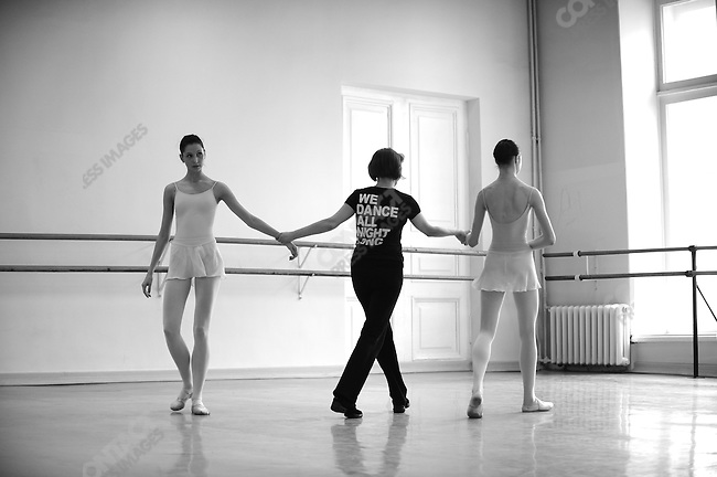 Girls from the eighth year at the Vaganova Ballet Academy in St. Petersburg worked on floor exercises and jumps during a daily class with teacher Irina Sitnikova. March 19, 2009