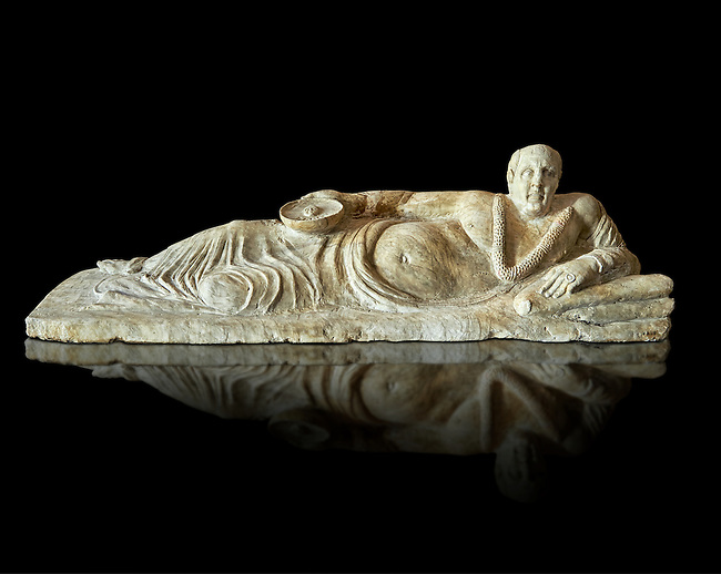 Etruscan Hellenistic style cinerary, funreary, urn cover with a man,  National Archaeological Museum Florence, Italy , black background