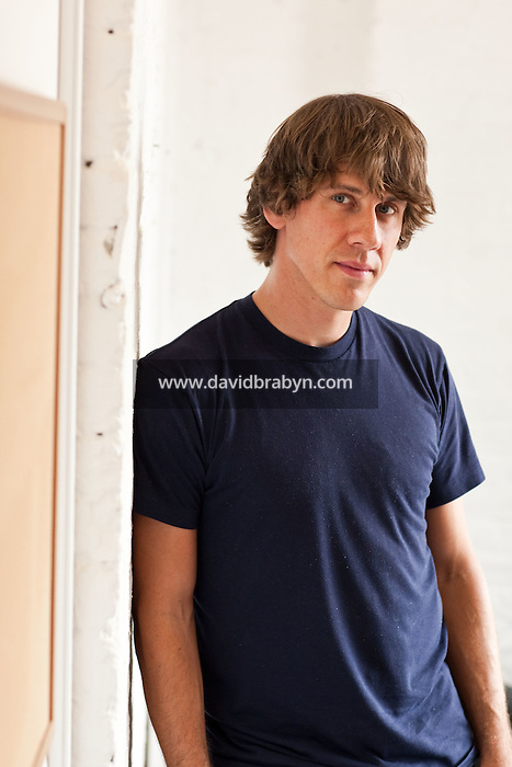 "Dennis Crowley, co-founder of social media website Foursquare poses for the photographer in their shared office in New York, USA, 5 August 2009. Foursquare, which allows users to stay connected to friends and explore a city, has been dubbed ""the next Twitter"" by an influential tech blog."