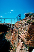 Scenic view of the Glen Canyon Bridge (steel arch construction), built to span the Colorado River. The Carl Hayden Visitor Center is on the right. Arizona.
