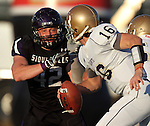 ROME, GA - DECEMBER 18: Dominic Studzinski #42 of the University of Sioux Falls closes in on quarterback Gary Wagner #16 of Carroll College in the first quarter at Barron Stadium in the 2010 NAIA National Football Championship in Rome, GA.(photo by Dave Eggen/Inertia)