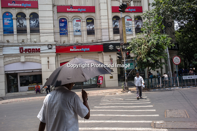 Pedestrians walk along the renovated British Colonial buildings on Park Street in Kolkata, West Bengal  on Friday, May 26, 2017. Photographer: Sanjit Das