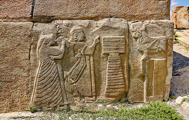 Pictures & Images Hittite relief sculpted orthostat panels of the Sphinx Gate. A king and Queen make offerings to a Bull God.  Alaca Hoyuk (Alacahoyuk) Hittite archaeological site  Alaca, Çorum Province, Turkey, Also known as Alacahüyük, Aladja-Hoyuk, Euyuk, or Evuk