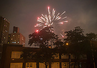 Illegal fireworks are launched from the Elliot Houses housing project in the Chelsea neighborhood of New York on Monday, July 4, 2016. (© Richard B. Levine)