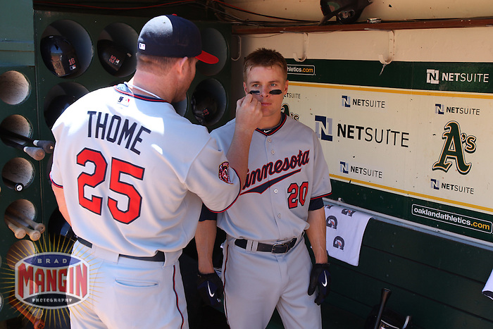 OAKLAND, CA - JUNE 6:  Jim Thome #25 of the Minnesota Twins applies eye black to teammate Matt Tolbert #20 in the Twins dugout before the game against the Oakland Athletics at the Oakland-Alameda County Coliseum on June 6, 2010 in Oakland, California. Photo by Brad Mangin