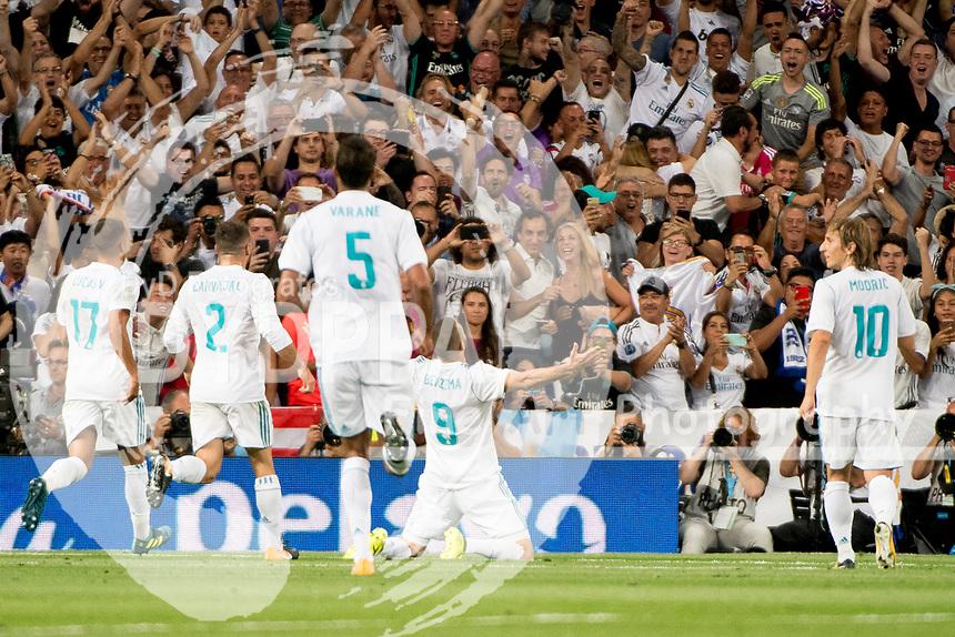 Real Madrid's French forward Karim Benzema celebrates after scoring