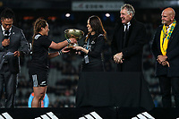 NZ Prime Minister Jacinda Ardern presents the Laurie O'Reilly Memorial Trophy to Black Ferns captain Fiao'o Fa'amausili after the international women's rugby match between the New Zealand Black Ferns and Australia Wallaroos at Eden Park in Auckland, New Zealand on Saturday 25 August 2018. Photo: Simon Watts / lintottphoto.co.nz