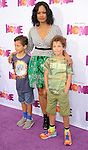 Garcelle Beauvais and sons arriving at the Los Angeles premiere of Home, held at Regency Village Theater on March 22, 2015