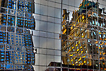 Reflections of buildings in Midtown Manhattan in windows.