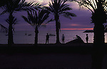 Group of people playing boule on the beach at dusk, Los Cristianos, Tenerife, Canary Islands.