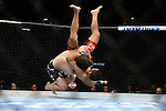 Las Vegas, NV - May 24, 2014: UFC welterweights, <br /> David Michaud (black trucks) slams  Li Jingliang  (red trunks) during their bout at UFC 173 inside the MGM Resort and Casino in Las Vegas, NV. (Al Powers for ESPN)