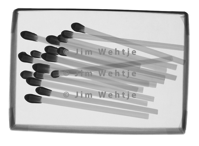 X-ray image of a box of matches (black on white) by Jim Wehtje, specialist in x-ray art and design images.