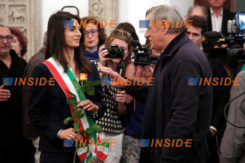 Don Luigi Ciotti prende una rosa e la regala alla neo sindaca Virginia Raggi<br /> Roma 28-06-2016 Campidoglio, camera ardente del regista Giuseppe Ferrara.<br /> Photo Samantha Zucchi Insidefoto