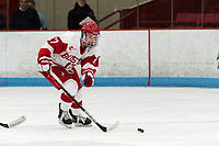 BOSTON, MA - JANUARY 04: Breanna Scarpaci #17 of Boston University brings the puck forward during a game between University of Maine and Boston University at Walter Brown Arena on January 04, 2020 in Boston, Massachusetts.