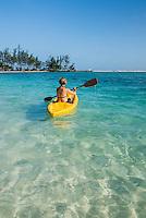 Honduras, Roatan Island, Fantasy Island Resort, Caribbean. Woman kayaking on the ocean (Lisa).