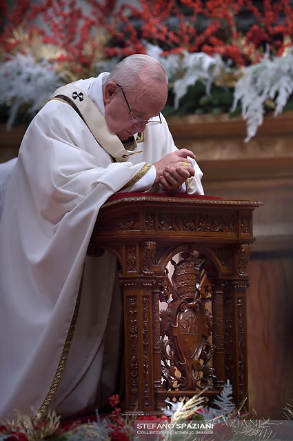 Pope Francis  during a mass on Christmas eve marking the birth of Jesus Christ on December 24, 2017 at St Peter's basilica in the Vatican.