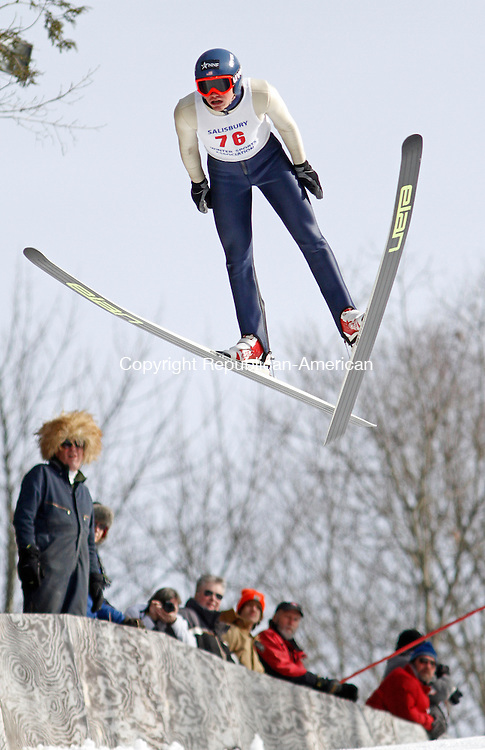 Salisbury, CT-020814MK05 Tyler Smith soars down the hill as distance volunteers look on during The Salisbury Invitational Competition on Saturday afternoon at Satre Hill in Salisbury.  Smith won the event with an overall score of 222.2. The Eastern U.S. Ski Jumping Championships begin today at 1 p.m.   Michael Kabelka / Republican-American