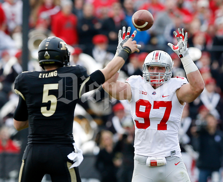 Ohio State Buckeyes defensive lineman Joey Bosa (97) tries to knock down a pass attempt by Purdue Boilermakers quarterback Danny Etling (5) during the second quarter of the NCAA football game at Ross-Ade Stadium in West Lafayette, Ind. on Nov. 2, 2013. (Adam Cairns / The Columbus Dispatch)