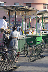 Vendors selling food at sunset at the Place Djemaa El-Fna in Marrakesh, Morocco.