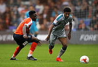 Pelly-Ruddock Mpanzu of Luton Town and Brandon Comley of Grimsby Town during the Sky Bet League 2 match between Luton Town and Grimsby Town at Kenilworth Road, Luton, England on 10 September 2016. Photo by Harry Hubbard / PRiME Media Images.