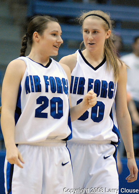 1 March 2008:  Air Force players, Raimee Beck (20) and Pamela Findlay (30) begin to celebrate the Falcon's 54-49 Mountain West Conference victory over the BYU Cougars at Clune Arena, U.S. Air Force Academy, Colorado Springs, Colorado.