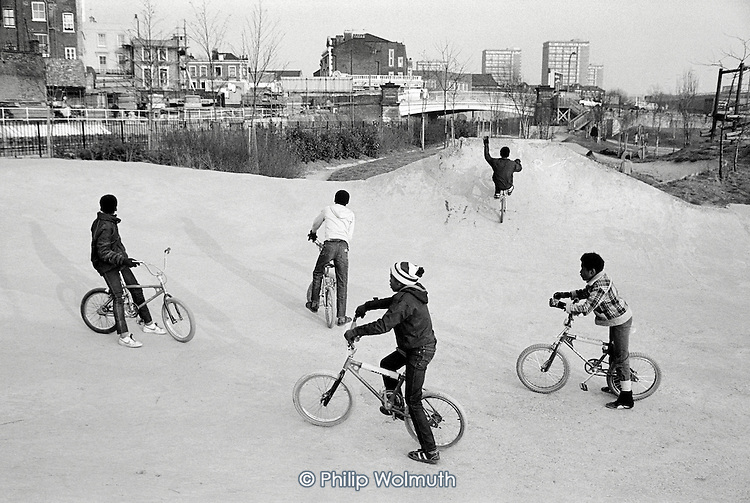 1983:  Young bikers on the first skateboard bowl in Meanwhile Gardens, a community-run park next to the Grand Union canal in North Paddington.  The bowl was replaced by a new, state-of-the-art design in 2002.