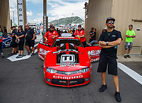 Jul 23, 2017; Morrison, CO, USA; Richie Stevens (right) stands alongside the car of his wife, NHRA pro stock driver Erica Enders-Stevens during the Mile High Nationals at Bandimere Speedway. Mandatory Credit: Mark J. Rebilas-USA TODAY Sports