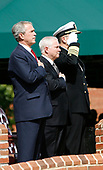 From left to right: United States President George W. Bush, US Secretary of Defense Robert Gates, and in-coming Chairman of the Joint Chiefs of Staff US Navy Admiral Michael Mullen during the National Anthem to begin an Armed Forces Change of Command ceremony and official Hail and Farewell tribute in honor of out-going Chairman of the Joint Chiefs of Staff, United States Marine Corps General Peter Pace and Admiral Mullen at Fort Myer, Virginia on October 1, 2007.<br /> Credit: Aude Guerrucci / Pool via CNP
