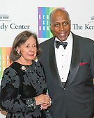 Vernon Jordan and his wife, Ann, arrive for the formal Artist's Dinner honoring the recipients of the 2013 Kennedy Center Honors hosted by United States Secretary of State John F. Kerry at the U.S. Department of State in Washington, D.C. on Saturday, December 7, 2013. The 2013 honorees are: opera singer Martina Arroyo; pianist,  keyboardist, bandleader and composer Herbie Hancock; pianist, singer and songwriter Billy Joel; actress Shirley MacLaine; and musician and songwriter Carlos Santana.<br /> Credit: Ron Sachs / CNP