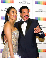 Lionel Richie and girlfriend Lisa Parigi arrive for the formal Artist's Dinner honoring the recipients of the 40th Annual Kennedy Center Honors hosted by United States Secretary of State Rex Tillerson at the US Department of State in Washington, D.C. on Saturday, December 2, 2017. The 2017 honorees are: American dancer and choreographer Carmen de Lavallade; Cuban American singer-songwriter and actress Gloria Estefan; American hip hop artist and entertainment icon LL COOL J; American television writer and producer Norman Lear; and American musician and record producer Lionel Richie. Photo Credit: Ron Sachs/CNP/AdMedia