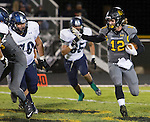 Galena Grizzlies #12 Quintin Mills runs around the outside of the Damonte Ranch Mustangs defense during their football game played on Thursday night, October 29, 2015 in Reno, Nevada.