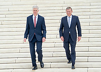 Chief Justice of the United States John G. Roberts, Jr. and Associate Justice Neil M. Gorsuch walk down the front steps of the US Supreme Court Building as they pose for photos after the investiture ceremony for Justice Gorsuch in Washington, DC on Thursday, June 15, 2017. Photo Credit: Ron Sachs/CNP/AdMedia