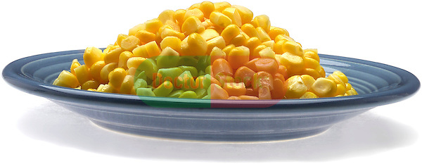 side plate of cut corn with butter on shadowless white background