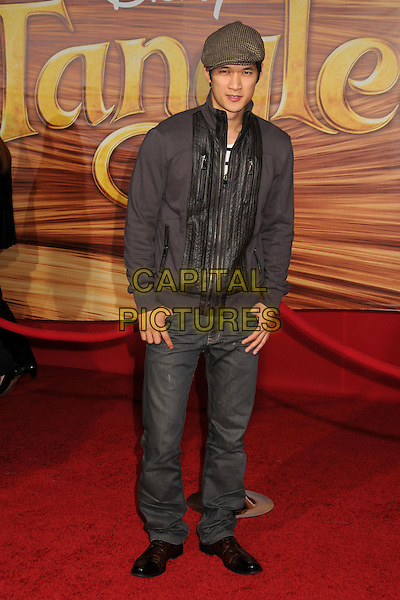 "HARRY SHUM JR..""Tangled"" Los Angeles Premiere held at the El Capitan Theatre, Hollywood, California, USA..November 14th, 2010.full length black beige flat cap hat jeans denim jacket.CAP/ADM/BP.©Byron Purvis/AdMedia/Capital Pictures."