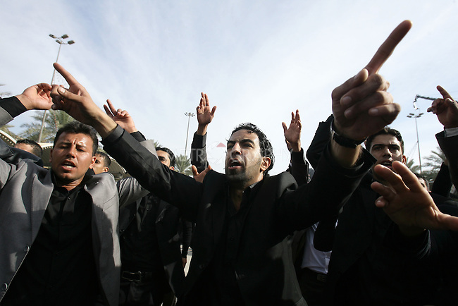KARBALA, IRAQ: A Shia pilgrims cry in mourning...Shia pilgrims pray during the last day of the Ashura festival...Photo by Metrography