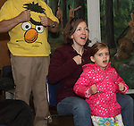 Vivienne Sweeny and her mother Kathleen Sweeny took a Laughter Yoga class at the Weymouth Public Libraries How-To Festival at the Tufts Library on Saturday April 25, 2015.(Photo by Gary Wilcox)