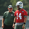 Chan Gailey, New York Jets Offensive Coordinator, left, talks to quarterback #14 Ryan Fitzpatrick during the first day of New York Jets team training camp at Atlantic Health Jets Training Center in Florham Park, NJ on Thursday, July 28, 2016.
