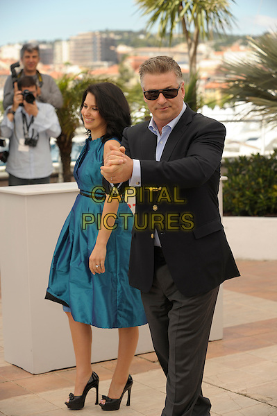 Hilaria Baldwin (nee Thomas) & Alec Baldwin .'Seduced and Abandoned' photocall.  Alec said that if the baby will be a boy, they will call him Thierry, a French name.  Perhaps he was joking.. 66th Cannes Film Festival, France 21st May 2013.full length black suit jacket blue shirt dress pregnant sunglasses shades hands together married husband wife .CAP/PL.©Phil Loftus/Capital Pictures.